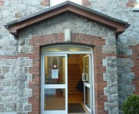 Granite and red brick entrance door