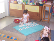 Child on floor doing jigsaw puzzle
